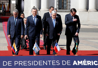Presidents and delegates arrive to pose for a family photo during the Prosur summit, at the presidential palace La Moneda, in Santiago