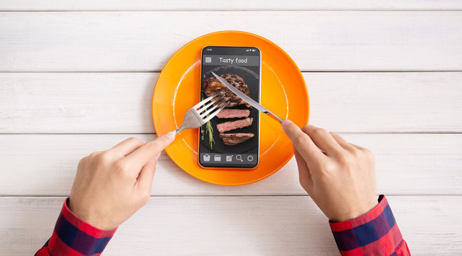 Man eating steak image on cellphone screen