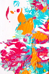 Pink Blue and Orange Paint Splatters on White Background