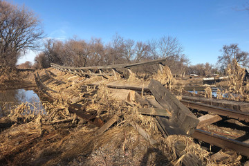 Railroad tracks and the bridge carrying it are seen destroyed by flood waters near Monroe Nebraska