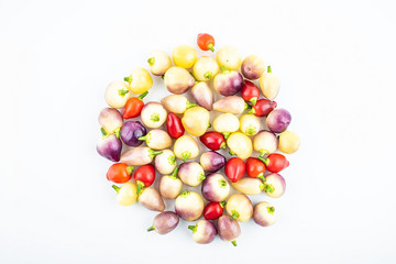 Bunch of fresh colorful peppers on white background