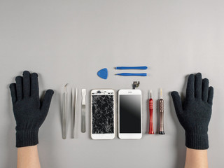Obraz Technician or engineer prepairing to repair and replace new screen broken and cracked screen smartphone prepairing on desk with copy space - fototapety do salonu