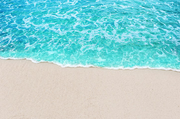 Wall Mural - Soft blue ocean wave and water sea clear on white sandy beach