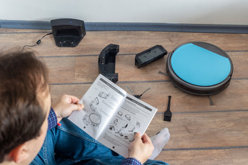 Reading the user guide for robot vacuum cleaner
