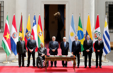 Presidents pose for a photo during the Prosur summit, at the presidential palace La Moneda, in Santiago