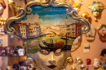 Italy, Venice, carnival 2019, typical Venetian masks and costumes in shop windows and in the street.