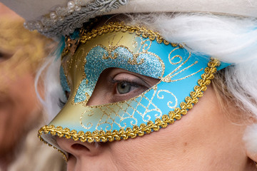 Italy, Venice, 2019, carnival, people with beautiful masks walk around Piazza San Marco, in the streets and canals of the city, posing for photographers and tourists, with colorful clothes.