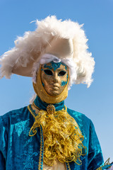 Italy, Venice,  carnival,  2019,  people with beautiful masks walk around Piazza San Marco, in the streets and canals of the city, posing for photographers and tourists, with colorful clothes.
