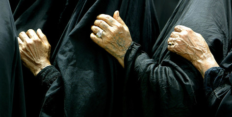 ELDERLY IRAQI WOMAN QUEUE AT PENSION OFFICE IN BAGHDAD.