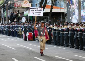 A man dressed as El Chavo del Ocho participates in a ceremony, a day  before Dia del Mar in La Paz