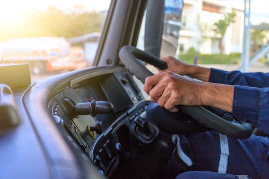 Truck driver keeps driving with hands