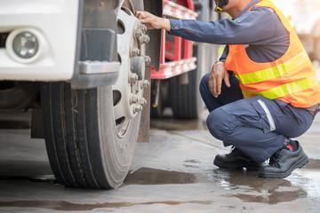 Preforming a pre-trip inspection on a truck,Concept preventive maintenance truck checklist,spot focus. Wall mural