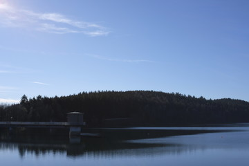 Water reservoir with a dam hydropower