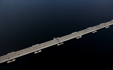 Cars travel on the Evergreen Point Floating Bridge, commonly known as the SR 520 bridge, in this aerial photo in Seattle