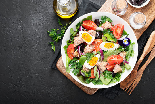 Tuna Fish Salad with Lettuce, Cherry Tomatoes, egg and olives.