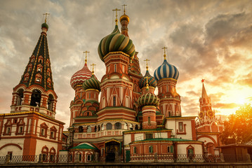 Wall Mural - St Basil`s Cathedral and Moscow Kremlin at sunset, Russia. St Basil`s temple is one of top tourist attractions of Moscow. Ancient architecture of Moscow in evening. Famous Moscow landmark in summer.