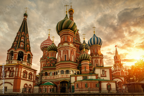 Fototapete St Basil`s Cathedral and Moscow Kremlin at sunset, Russia. St Basil`s temple is one of top tourist attractions of Moscow. Ancient architecture of Moscow in evening. Famous Moscow landmark in summer.
