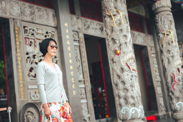 Asian woman stand in the Wenwu temple