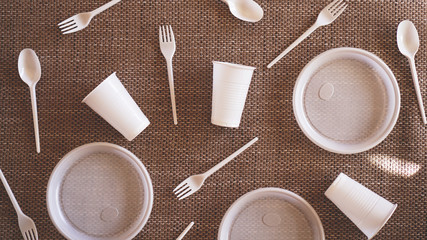 Plastic collection on beige background. Concept of Recycling plastic and ecology. Flat lay, top view