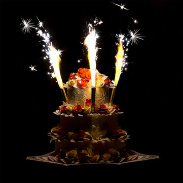 festive bright cake colorful fireworks on a dark background contrasting colorful wedding background celebrating the creation of a family