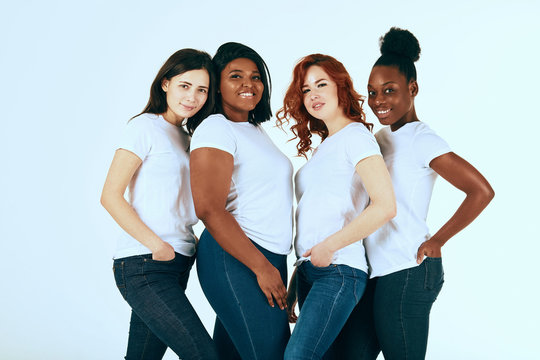 friendship, fashion, body positive, diverse female beauty concept - group of happy multicultural different size women in casual wear posing on white background