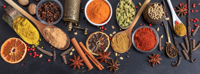 Spices and herbs. Colorful spices flat lay on wooden table