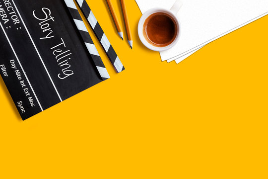Story telling text title on movie clapper board  and coffee cup on yellow background