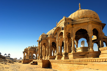 Fototapete - Ancient royal cenotaphs and archaeological ruins at Jaisalmer Bada Bagh Rajasthan, India