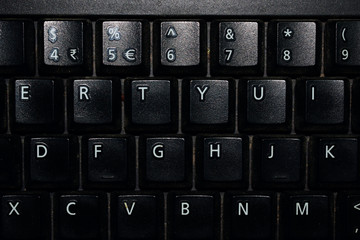 Black keyboard with alphabets and numbers