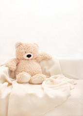 Children's toys - bears of brown and beige color are sitting on the sofa.