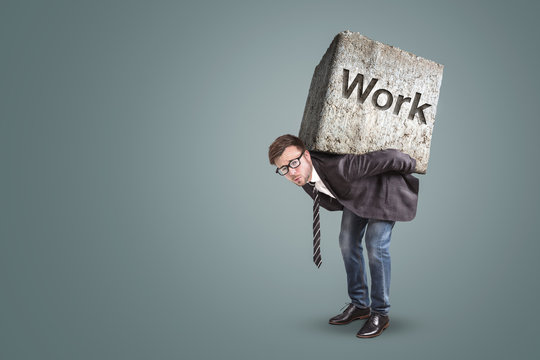 Concept of an entrepreneur bending under a heavy workload