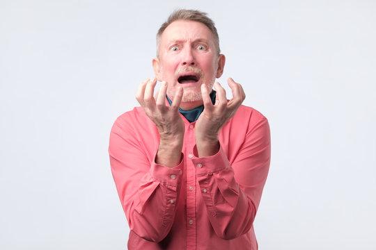 Senior man asking somebody about wrong decision