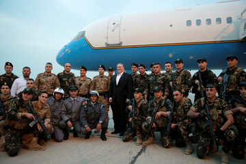 U.S. Secretary of State Mike Pompeo poses for a picture with military personnel before boarding his plane, in Beirut