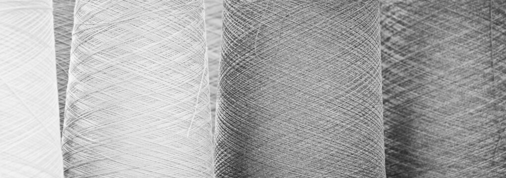 Black and white reels of threads. web banner background