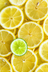 Lemon slices with one cut lime slice closeup