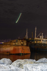 Acrylic Prints Shipwreck ship wrecks near coast line during night time, environmental issue, ecological problem, light trails on the sky