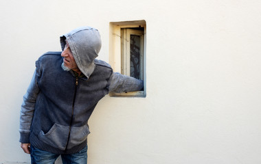 Burglar or thief or robber is stealing with arm through the small window