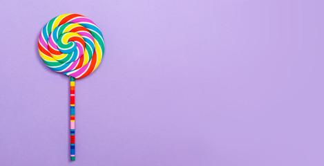 Big lollipop on a purple paper background