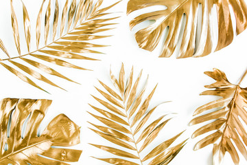 Wall Mural - Gold tropical palm leaves on white background. Flat lay, top view minimal concept.