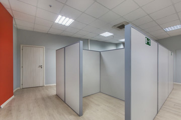 An empty office space with unfurnished cubicles