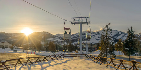 Ski Lifts in Patk City against mountain and sun