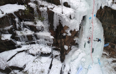 Participants compete in a regional ice climbing and winter rock climbing junior championship outside Krasnoyarsk