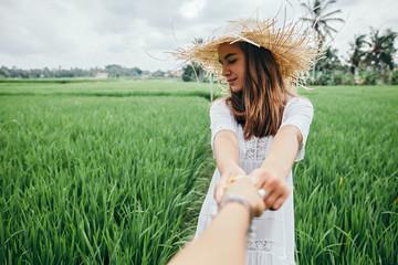 Young girl walking in rice field in Bali