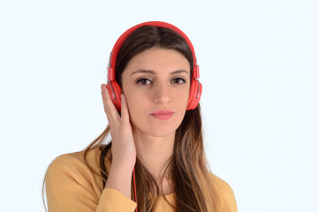 Young woman listening to music in studio.