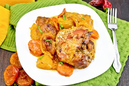 Chicken roast with pumpkin and carrots on green towel