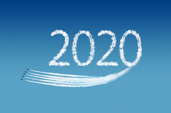 2020 text, computer graphics, represented by airplane trails. New Year Concept.