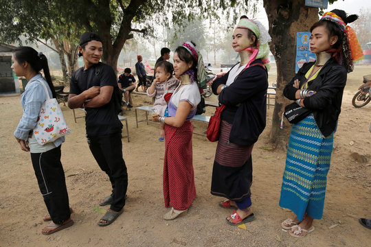 Ethnic Kayan also known as long neck villagers arrive at a polling station in Ban Huadua school to cast their votes for the general election in Mae Hong Son