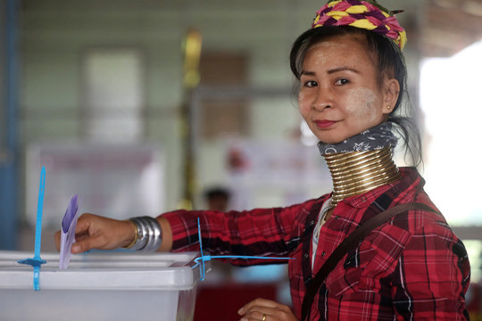 An ethnic Kayan woman, also known as a long neck villager casts her vote for the general election in Mae Hong Son