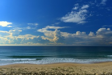 Wall Mural - Australian Coastline Diamond Beach summer beach scene with storm clouds on horizon