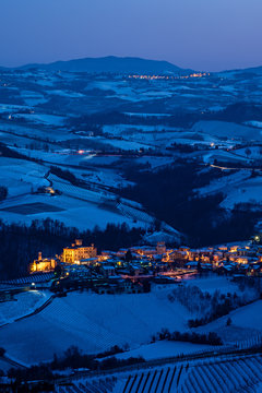 Barolo village panorama in Langhe hills in winter, blue hour